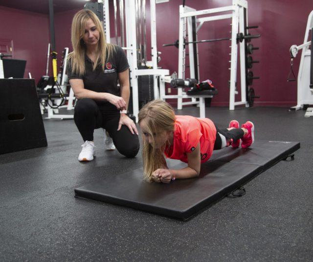Gym Member Holding Plank